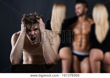 anger and betrayal man with bare chest near group of people of shouting guy and women in love relations on blurred background lesbian and gay