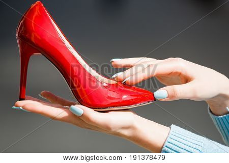 Footwear Or Shoe Red Color Leather On Female Hand