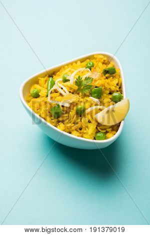 Indian Breakfast Dish Poha Also Know as Pohe or Aalu poha made up of Beaten Rice or Flattened Rice. The rice flakes are lightly fried in oil with mustard, chilly, onion & turmeric, served with hot tea