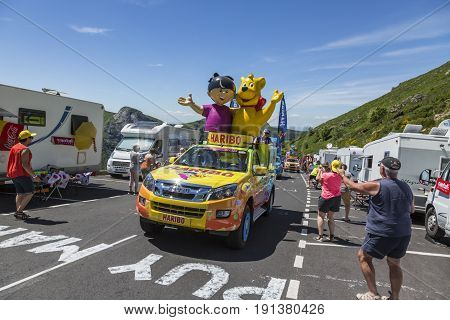Pas de Peyrol France - July 62016: Haribo vehicle during the passing of the Publicity Caravan on the road to Pas de Pyerol (Puy Mary) in Cantalin the Central Massif during the stage 5 of Tour de France on July 6 2016. Haribo is the biggest manufacturer of