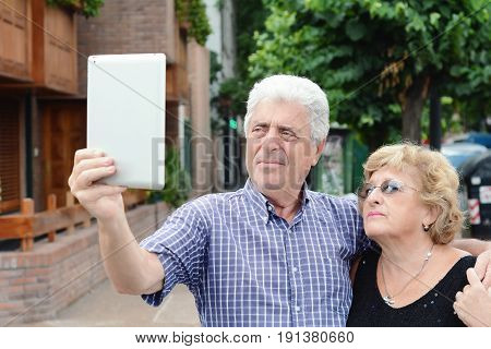 Old Couple Taking Selfie With Tablet.