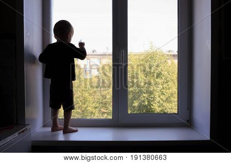 Crisis Child Concept. The Child Looks Window
