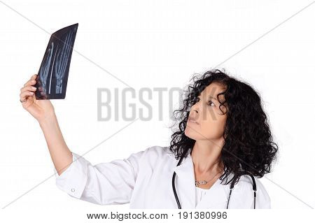Portrait of medical doctor woman examing xray. Medical and medicine concept. Isolated white background.