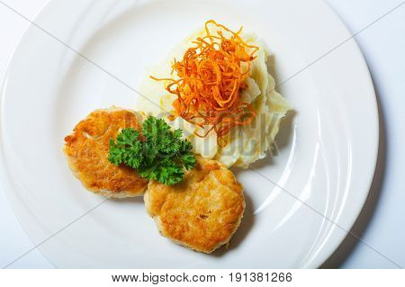 Homemade Fried Meatballs With Mashed Potatoes On White Plate Close Up