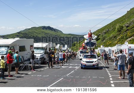 Pas de Peyrol France - July 62016: Le Gaulois Caravan during the passing of the Publicity Caravan on the road to Pas de Pyerol (Puy Mary) in Cantalin the Central Massif during the stage 5 of Tour de France on July 6 2016. Le Gaulois is an important French