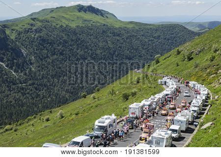 Pas de Peyrol France - July 62016: Cochonou Caravan during the passing of the Publicity Caravan on the road to Pas de Pyerol (Puy Mary) in Cantalin the Central Massif during the stage 5 of Tour de France on July 6 2016. Cochonou is an important French bra