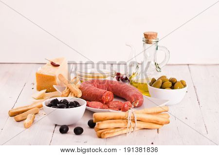 Grissini breadsticks with salami and parmesan cheese.