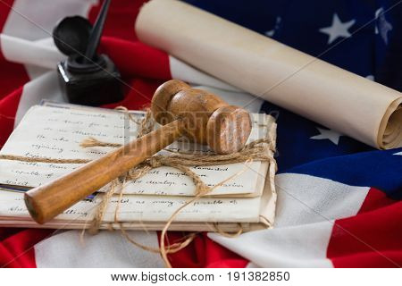 Close-up of gavel and legal documents arranged on American flag