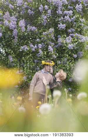 Happy Middle Aged Couple In Blooming Garden