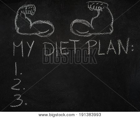 Fitness arms and My diet plan list drawn with chalk on blackboard