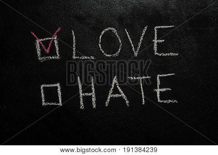 Love or Hate written with white chalk on blackboard