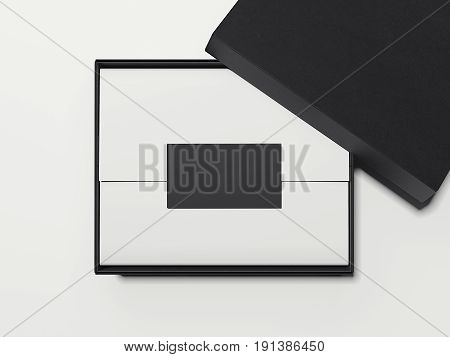 Black box with white wrapping paper and business card isolated on bright background. 3d rendering
