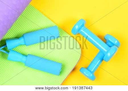 Set Of Sports Equipment Holding Blue Skipping Rope Handles