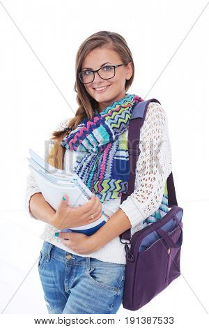 Portrait of young student woman holding exercise books. Student.
