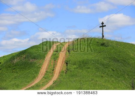 road to cross on green hill top