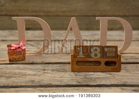 Close up of calender with dad text on wooden table