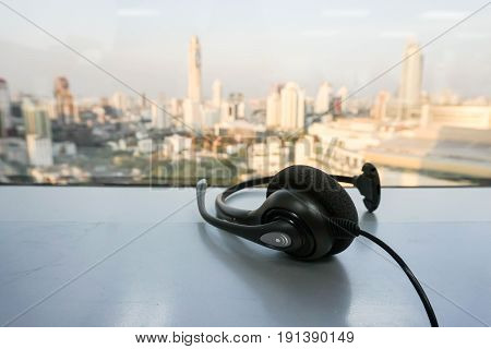 IP phone headset for customer service in city view backdrop