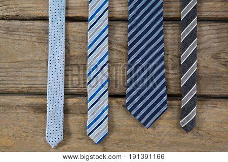 Overhead view of neckties on wooden table