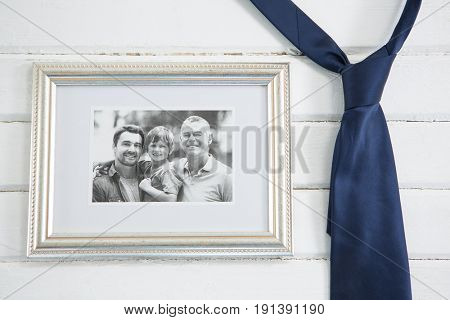 Close up of picture frame by necktie on white table