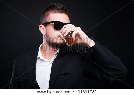 Glamorous Handsome Male Drinking Expensive Whiskey