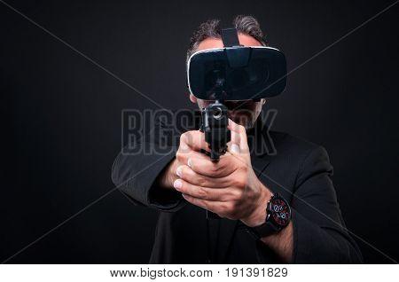 Mafia Member Aiming Gun At The Camera