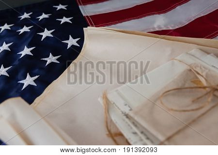 Close-up of legal documents arranged on American flag