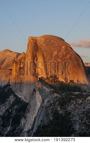 The setting sun illuminates Half dome, as seen from Glacier Point. Yosemite National Park, California, USA.
