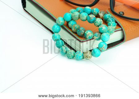 Variscite Round Bead Stretchy Bangle Bracelets on notebook on white background