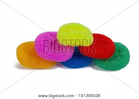 Heap of various nylon scrubbers arranged on white background