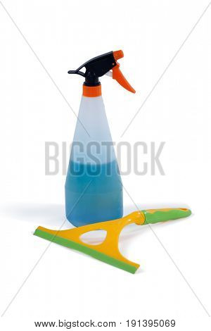 Detergent spray bottle and window squeegee arranged on white background