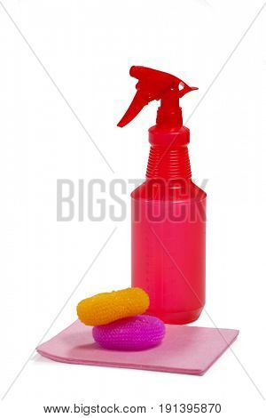Spray bottle, scrubbers and cleaning pad arranged on white background
