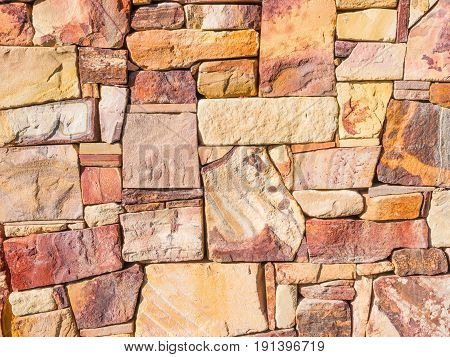 A rock wall background made from colorful Australian rocks.