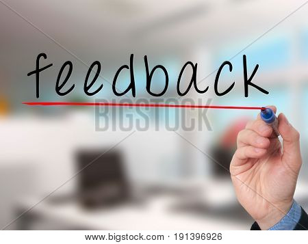 Feedback Concept With Businessman Hand Writing