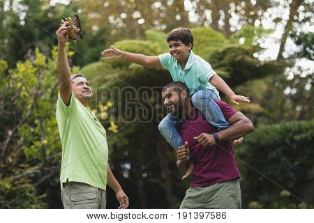 Happy multi generation family enjoying at park