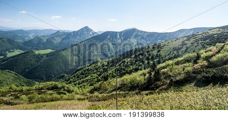 spring Mala Fatra mountains with Maly Rozsutec Velky Rozsutec Stoh and other hills from hiking trail near sedlo Bublen in Slovakia with blue sky and only few clouds