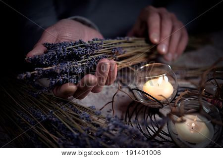Candles candle holder dry lavender in men's hands
