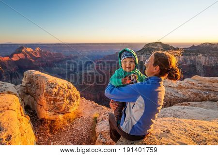 A mother with baby son in Grand Canyon National Park North Rim Arizona USA