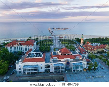 Sopot Poland - June 10 2017: Bird-eye view of Sheraton hotel against the wooden pier on the background in evening