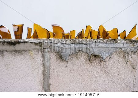 Broken bottles on the top of a wall for anti thief