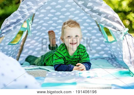 Funny funny little boy playing in the park. 2-3 years. The concept of lifestyle picnic and childhood.