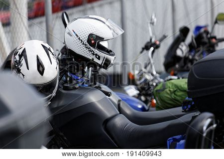 Moto Helmets On Motorcycle Handlebars