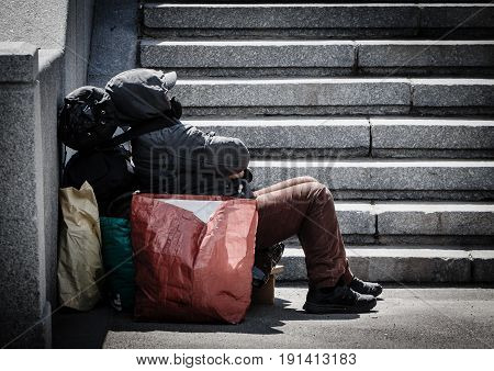 Homeless man with all his things on the street in Moscow