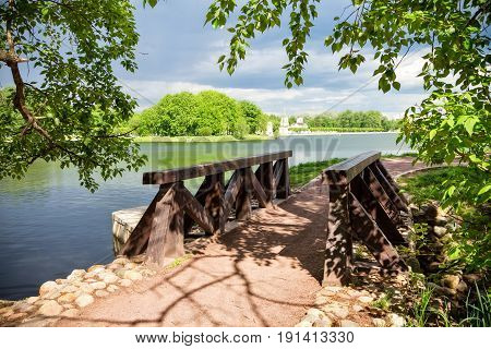 Wooden bridge in the shade of a tree