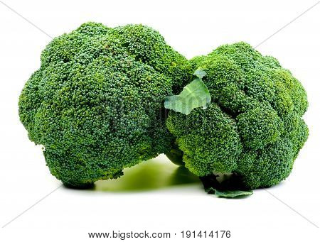 Two Perfect Raw Fresh Broccoli with Leaf closeup on White background