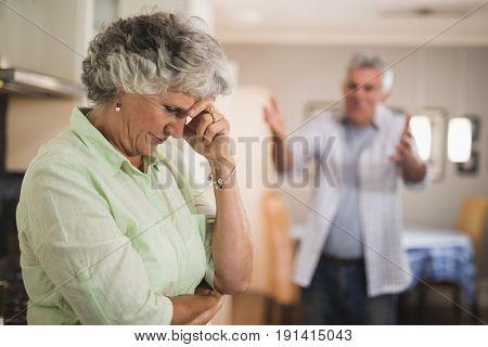 Angry senior man yelling on senior woman at home