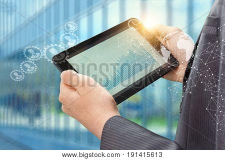Businessman Working With Graph Statistics .