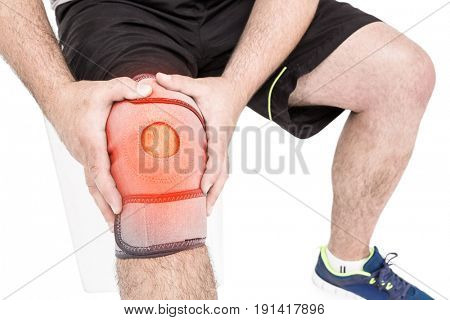 Digitally composite image of man suffering with knee inflammation