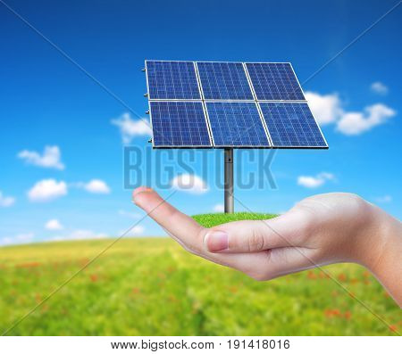 Hand holding solar panel. Photovoltaic panel generate clean energy.