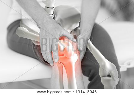 Digitally composite image of man suffering with knee inflamation