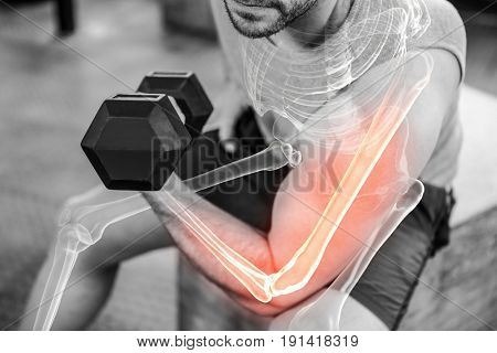 Digital composite of highlighted arm of strong man injecting anabolic steroid at gym